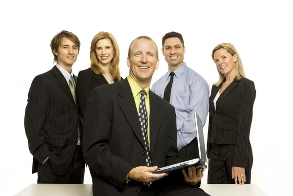 bigstockphoto_Business_People_Near_Desk_resize
